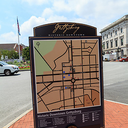 Gettysburg, PA, USA - June 30, 2013:  A map of the town on a signpost in Lincoln Square to assist visitors while in Gettysburg.