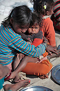 Children, some who have run away from their families, find themselves living homeless on the train tracks waititng for the next train to arrive at the train station in Jaipur, India.  Once the train arrives they raid the train looking for plastic bottles that they can then sell.  Most will make about $1.50/day but spend most of it on glue which they are most addicted to.