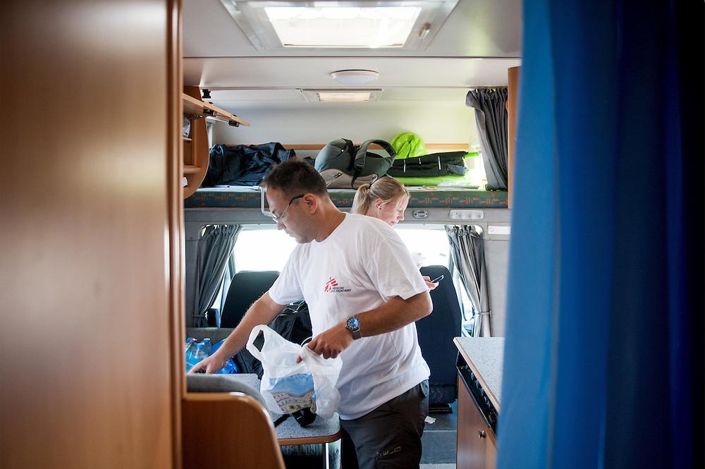 MSF doctor Dimitris Giannousis and MSF nurse Ida Tornstensson preparing the mobile unit a camper van of MSF at Mytiline port, Lesvos, Greece.