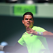Milos Raonic of Canada returns a ball from Jeremy Chardy of France during their match at the Miami Open tennis tournament at Crandon Park on Monday, March 30, 2015 in Key Biscayne, Florida. (AP Photo/Alex Menendez)