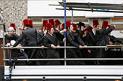 © London News Pictures. 24/03/2016.  A group of young Orthodox Jewish men ride in the back of a truck while listening to music as they  celebrate the festival of Purim in the streets of Stamford Hill in north London. Purim celebrates the miraculous salvation of the Jews from a genocidal plot in ancient Persia, an event documented in the Book of Esther. Traditionally the jewish community wear fancy dress and exchange reciprocal gifts of food and drink. Photo credit: Tolga Akmen/LNP