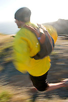 Jason Reale running near the California Coastal Trail; Golden Gate National Recreation Area. San Francisco,  CA