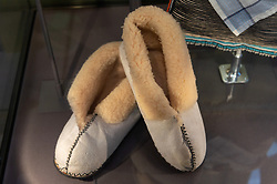 © Licensed to London News Pictures. 07/02/2019. London, UK. A pair os sheepskin slippers worn by Nelson Mandela is showing as part of the Mandela: The Exhibition takes visitors on a personal journey through the life of the world's most iconic freedom fighter and political leader. Photo credit: Ray Tang/LNP