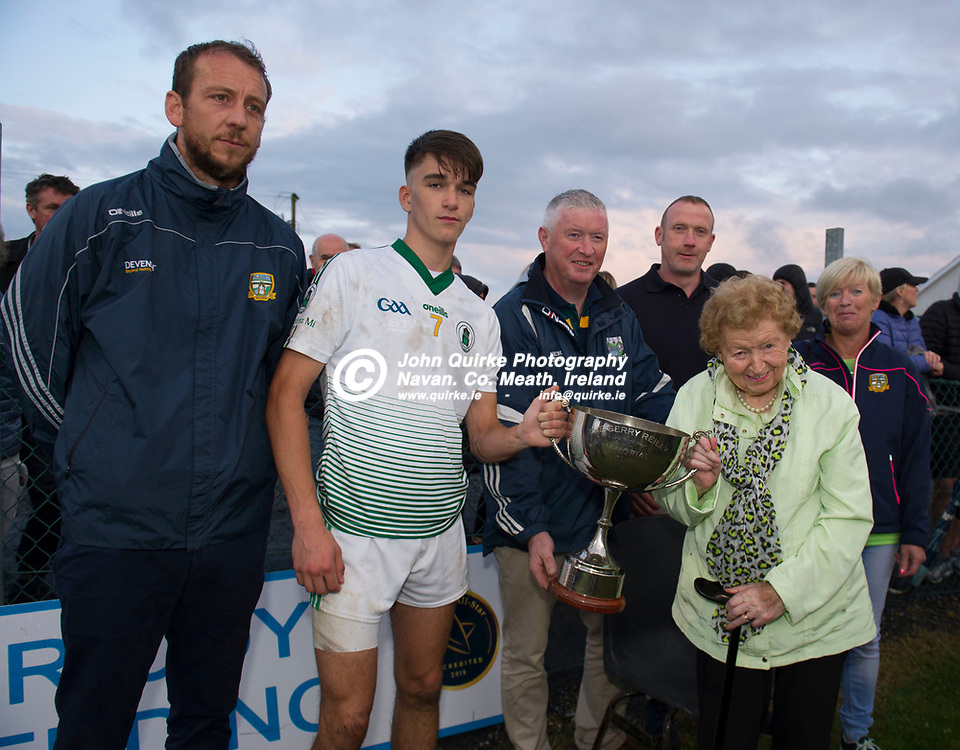 20-08-19. Meath v Dublin - Gerry Reilly Leinster U-16 Football Tournament Final at Millbrook, Oldcastle. Co. Meath.<br /> Clare O'Reilly, presenting the Gerry Reilly Cup to Meath Captain Ciaran Caulfield with from left, Jamie Queeney, Meath Coaching & Games Development Manager. Martin Reilly, Martin Briody, Briody Bedding (Sponsor) and Andre Reilly.<br /> Photo: John Quirke / www.quirke.ie<br /> ©John Quirke Photography, Unit 17, Blackcastle Shopping Cte. Navan. Co. Meath. 046-9079044 / 087-2579454.