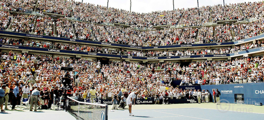 Andre Agassi (center bottom in white) bows to the crowd after the final match of his career at the 2006 US Open in Flushing Meadows, New York on Sunday 03 September 2006.