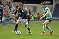 Millwall midfielder Connor Mahoney  (21)  and Leicester City Defender Luke Thomas (33) battles for possession during the EFL Cup match between Millwall and Leicester City at The Den, London, England on 22 September 2021.