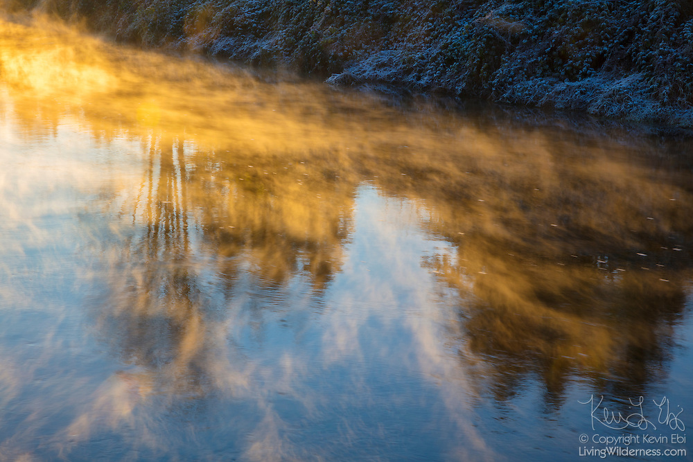 Steam fog, also known as sea smoke, rises from the Sammamish River near Woodinville, Washington, on a cold morning. Steam fog occurs when cold air — it was 22 degrees Fahrenheit at the time this image was captured — passes over warmer water. Moisture rises from the relatively warm river and turns to vapor inches above the surface when it hits the freezing-cold air.