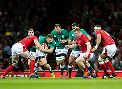 Andrew Conway of Ireland under pressure from Adam Beard of Wales<br /> <br /> Photographer Simon King/Replay Images<br /> <br /> Friendly - Wales v Ireland - Saturday 31st August 2019 - Principality Stadium - Cardiff<br /> <br /> World Copyright © Replay Images . All rights reserved. info@replayimages.co.uk - http://replayimages.co.uk