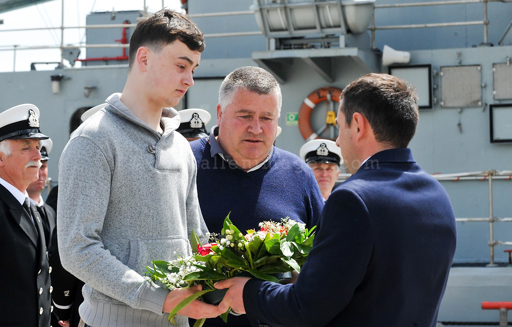 REPRO FREE<br /> Newly appointed Kinsale Harbour Master Julian Renault presents a wreath to laid at sea to Joe Bohan and John O'Mahony to be  at the annual Sea Sunday service and parade in Kinsale.<br /> Picture. John Allen