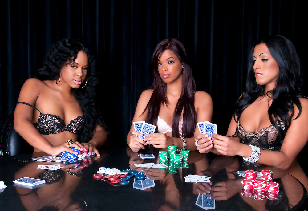Young girls playing poker in lingerie and having fun.