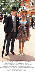 TV presenter BRUCE FORSYTH and his wife WILNELIA,  at Royal Ascot on 17th June 2003.PKN 179