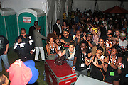 August 25, 2012-Brooklyn, NY: Crowds await Recording Artist Erykah Badu backstage at the Afropunk Festival 2012 held in Brooklyn, NY on August 25, 2012. The Afropunk Festival has become a Brooklyn intuition, the focal point for the burgeoning Afro-punk movement. Over the past seven years, the festival has presented new artists before they hit it big, such as Grammy-nominated Santigold, The Noisettes and Janelle Monae. Afro-punk mainstays like Saul Williams, The Dirtbombs, and Dallas Austin have also graced Afro-punk's stages. (Terrence Jennings/TerrenceJennings.com)