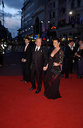 Catherine Zeta-Jones and Michael Douglas. Arriving for the Baftas, Leicester Sq. 23  February 2003. © Copyright Photograph by Dafydd Jones 66 Stockwell Park Rd. London SW9 0DA Tel 020 7733 0108 www.dafjones.com