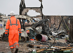 """Demolition workers start breaking down living areas of the """"Jungle"""" migrant camp, close to Calais in northern France."""