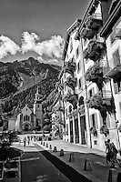 Black and White street view of Hotel De Ville, Church, and the French Alps - Chamonix, France (Vertical).