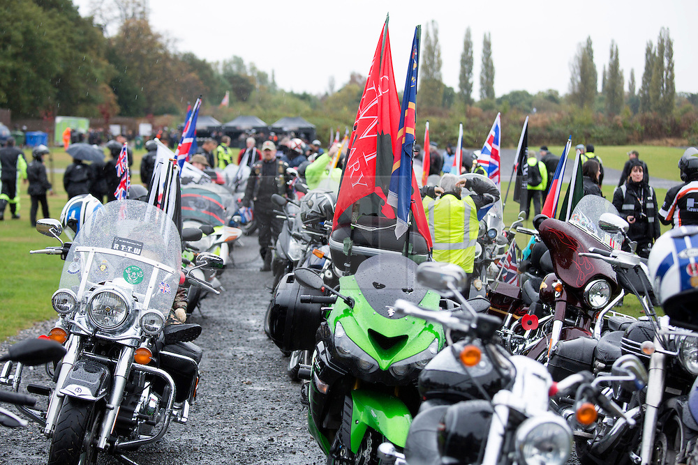"""© Licensed to London News Pictures. 04/10/2014. Alrewas, Staffordsire, UK. The 2014 Ride to the Wall took place today. Over six thousand riders started from six points to Ride To The Wall, at the National Memorial Aboretum in Staffordshire. The seventh time the event has taken place and has now become an annual pilgramage for ex-servicemen and those currently serving in the Armed Forces. Pictured, riders assembling in Drayton Manor Park ready for the run to the """"Wall"""". Photo credit : Dave Warren/LNP"""
