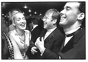 Jerry Hall, Elton John and David Furnish, tiffany;s Elsa Peretti and 10th anniversary Party. Quaglino's. London. 2 September 1996. © Copyright Photograph by Dafydd Jones 66 Stockwell Park Rd. London SW9 0DA Tel 020 7733 0108 www.dafjones.com