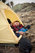 Backpacker Charlie Bloch naps in his tent at camp above Parika Lake, Never Summer Wilderness, Colorado.