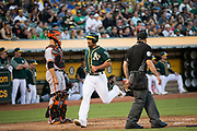 Oakland Athletics shortstop Marcus Semien (10) scores a run against the San Francisco Giants at Oakland Coliseum in Oakland, California, on August 1, 2017. (Stan Olszewski/Special to S.F. Examiner)
