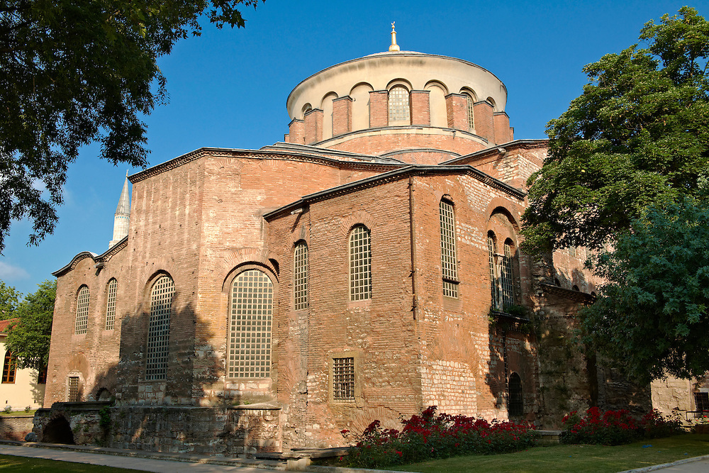 """Hagia Irene or Hagia Eirene ( , """"Holy Peace"""", Aya rini), the first Christian Roman Basilica built in Constantinople by Emperor Constantine. Rebuilt by Emperor Justinian I had the church restored in 548 and dedicated to his wife Now just inside the walls of the Topkapi Palace with the 19th century historic Ottoman houses of Soukçeme Soka in the foreground , Istanbul Turkey .<br /> <br /> If you prefer to buy from our ALAMY PHOTO LIBRARY  Collection visit : https://www.alamy.com/portfolio/paul-williams-funkystock/istanbul.html<br /> <br /> Visit our TURKEY PHOTO COLLECTIONS for more photos to download or buy as wall art prints https://funkystock.photoshelter.com/gallery-collection/3f-Pictures-of-Turkey-Turkey-Photos-Images-Fotos/C0000U.hJWkZxAbg"""