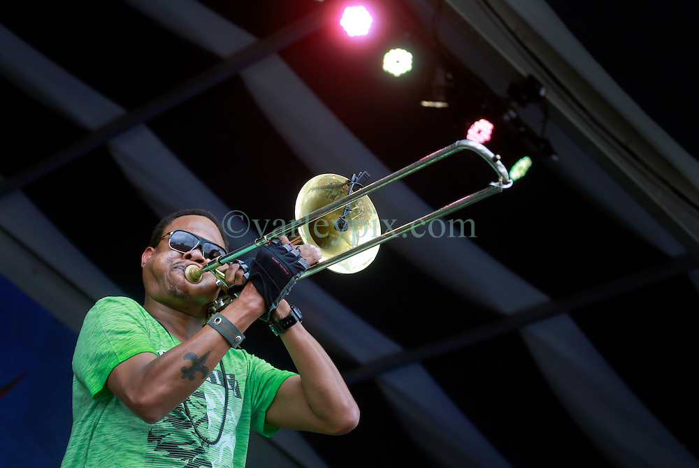 27 April 2014. New Orleans, Louisiana.<br /> Corey Henry takes to the stage with Galactic at the New Orleans Jazz and Heritage Festival. <br /> Photo; Charlie Varley/varleypix.com
