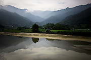 Japan Yakushima Island -  A deep valley with a reflexion of mountain in the water.
