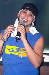 Billy Crawford supporting Liberty -X at Sheffield City Hall March 18 2003<br /> <br /> Copyright Paul David Drabble<br /> [#Beginning of Shooting Data Section]<br /> Nikon D1 <br /> 2003/03/18 20:33:36<br /> JPEG (8-bit) Fine<br /> Image Size:  2000 x 1312<br /> Color<br /> Lens: 80-200mm f/2.8-2.8<br /> Focal Length: 92mm<br /> Exposure Mode: Manual<br /> Metering Mode: Spot<br /> 1/250 sec - f/3.2<br /> Exposure Comp.: 0 EV<br /> Sensitivity: ISO 800<br /> White Balance: Auto<br /> AF Mode: AF-S<br /> Tone Comp: Normal<br /> Flash Sync Mode: Front Curtain<br /> Auto Flash Mode: External<br /> Color Mode: <br /> Hue Adjustment: <br /> Sharpening: Normal<br /> Noise Reduction: <br /> Image Comment: <br /> [#End of Shooting Data Section]