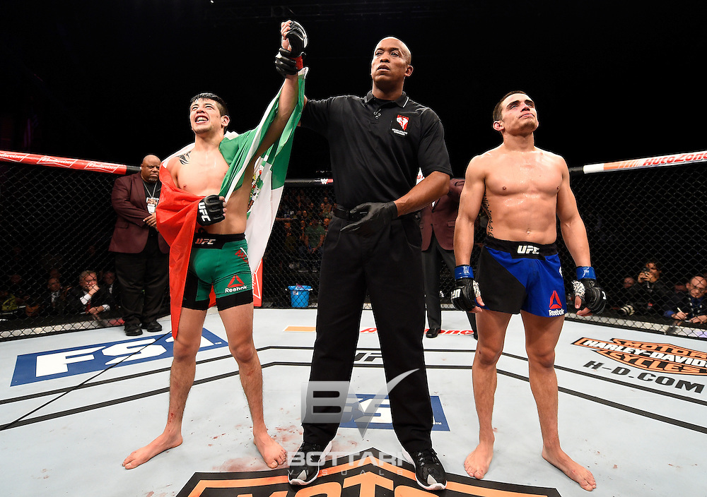LAS VEGAS, NV - DECEMBER 03:  Brandon Moreno of Mexico celebrates his split-decision victory over Ryan Benoit in their flyweight bout during The Ultimate Fighter Finale event inside the Pearl concert theater at the Palms Resort & Casino on December 3, 2016 in Las Vegas, Nevada. (Photo by Jeff Bottari/Zuffa LLC/Zuffa LLC via Getty Images)