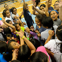 062314  Adron Gardner/Independent<br /> <br /> Lady Scout volleyball campers assemble for a cheer at the Stronghold Events Center in Fort Defiance Monday.