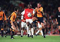 Patrick Vieira (Arsenal) Jamie Carragher and Nick Barmby (Liverpool). Arsenal 2:0 Liverpool, F.A.Carling Premiership, 21/8/2000. Credit : Colorsport / Stuart MacFarlane.