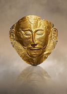 Mycenaean gold death mask, Mask of Agamemnon, Grave Cicle A, Mycenae, Greece.National Archaeological Museum of Athens.<br /> <br /> The mask from Grave V depicts an imposing face of a bearded man descovered by  Heinrich Schliemann who believed it was the body of Agamemnon, this is unproven to date.  The Mycenaean death mask belonged to a warrior and made of gold leaf it cocered the dead mans face held on by cord threaded tgrough the two sides of the mask.  The mask of Agamemnon was created from a single thick gold sheet, heated and hammered against a wooden background with the details chased on later with a sharp tool. The artifact dates from the 16th century BC. .<br /> <br /> If you prefer to buy from our ALAMY PHOTO LIBRARY  Collection visit : https://www.alamy.com/portfolio/paul-williams-funkystock/mycenaean-art-artefacts.html . Type -   Athens    - into the LOWER SEARCH WITHIN GALLERY box. Refine search by adding background colour, place, museum etc<br /> <br /> Visit our MYCENAEN ART PHOTO COLLECTIONS for more photos to download  as wall art prints https://funkystock.photoshelter.com/gallery-collection/Pictures-Images-of-Ancient-Mycenaean-Art-Artefacts-Archaeology-Sites/C0000xRC5WLQcbhQ