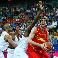 08 August 2012: Spain Pau Gasol drives past Ali Traore during 66-59 Team Spain victory over Team France, during the men's basketball quarter-finals, at the 02 Arena, in London, Great Britain.