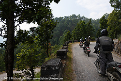 Led Sled's Pat Patterson, Biltwell photographer Geoff Kowalchuk and the rest of the Biltwell crew riding mountain curves on Motorcycle Sherpa's Ride to the Heavens motorcycle adventure in the Himalayas of Nepal. Riding from Chitwan to Daman. Tuesday, November 12, 2019. Photography ©2019 Michael Lichter.