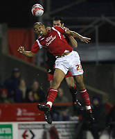 Photo: Steve Bond/Richard Lane Photography. Nottingham Forest v Doncaster Rovers. Coca Cola Championship. 28/11/2009. Dexter Blackstock (front) gets to the ball in front of Jason Shackell