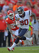 KANSAS CITY, MO - OCTOBER 20:  Wide receiver Andre Johnson #80 of the Houston Texans rushes past defensive back Brandon Flowers #24 of the Kansas City Chiefs during the first half on October 20, 2013 at Arrowhead Stadium in Kansas City, Missouri.  (Photo by Peter Aiken/Getty Images) *** Local Caption *** Andre Johnson;Brandon Flowers