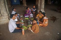 Family having a picnic at Temple at Tiruchirapalli; Tamil Nadu; India,