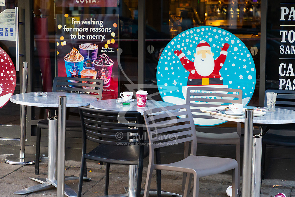 Drinks lie abandoned on outside tables as a police cordon is in place in the are surrounding a Costa Coffee outlet on Bowes Road in Arnos green following a stabbing in which a male victim has been left in critical condition. Arnos Grove, North London, November 12 2018.