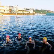 Four early morning swimmers,Newcastle Ocean Baths, Newcastle, Australia