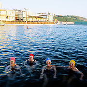 Four early morning swimmers,Newcastle Ocean Baths, Newcastle, Australia