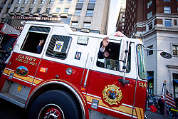 November 22, 2018 - Philadelphia, Pennsylvania, United States - Firefighers from the Darby Fire Company wave to spectators during the Thanksgiving Day Parade in Philadelphia, November 22, 2018. Thousands of spectators turn out along the Ben Franklin Parkway in downtown Philadelphia for the 6ABC Dunkin' Donuts Thanksgiving Day Parade. Temperatures hovered in the mid-20's with moderate winds. (Credit Image: © Michael Candelori/NurPhoto via ZUMA Press)