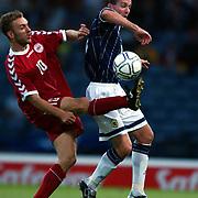 l-r;  Denmark's Dennis Rommedahl battles for possession of the ball with Scotland's Paul Lambert