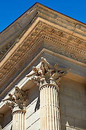 Corinthian Capitals of the Maison Carrée, a ancient Roman temple built around 4-7 AD and dedicated to Julius Caesar, the best preserved example of a Roman temple,  Nimes, France . In about 4-7 AD, the Maison Carrée was dedicated or rededicated to Gaius Caesar and Lucius Caesar, grandsons and adopted heirs of Augustus who both died young. The Maison Carrée is a classic example of Vitruvian architecture as it is nearly an exact replica of a Tuscan style Roman temple described in the writings of the famous architect Vitruvius. Raised on a 2.85 m high podium, and at 26.42 m by 13.54 m forming a rectangle almost twice as long as it is wide, the temple dominated the forum of the Roman city of Nîmes. .<br /> <br /> Visit our ROMAN ART & HISTORIC SITES PHOTO COLLECTIONS for more photos to download or buy as wall art prints https://funkystock.photoshelter.com/gallery-collection/The-Romans-Art-Artefacts-Antiquities-Historic-Sites-Pictures-Images/C0000r2uLJJo9_s0