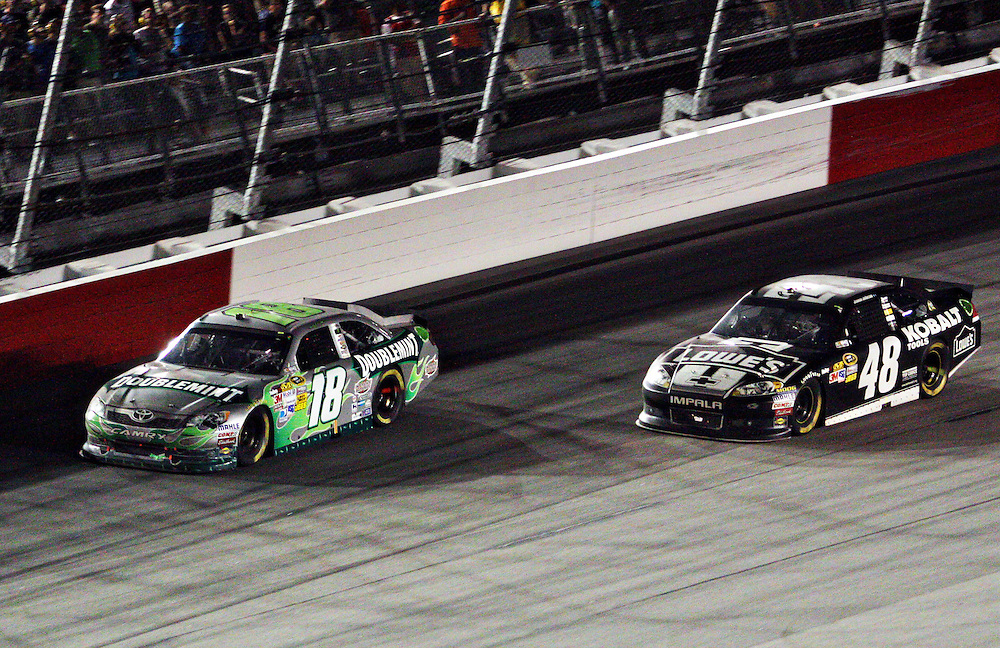 May 12, 2012; Darlington, SC, USA; NASCAR Sprint Cup drivers Kyle Busch (18) and Jimmie Johnson (48) during the Southern 500 at Darlington Raceway. Mandatory Credit: Peter Casey-US PRESSWIRE.