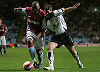 Photo: Lee Earle.<br /> Aston Villa v Fulham. The Barclays Premiership. 21/10/2006. Villa's Didier Agathe (L) battles with Frank Queudrue.