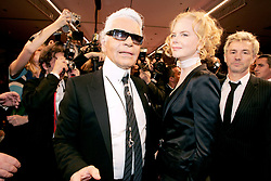 German stylist Karl Lagerfeld,Australian actress Nicole Kidman and Australian director Baz Luhrmann during Lagerfeld's Spring/Summer 2005 Ready-to-Wear collection presentation for the French fashion house Chanel at the Carrousel du Louvre in Paris, France, on October 8, 2004. Photo by Klein-Nebinger/ABACA.