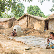CAPTION: Working on a thatched roof. LOCATION: Singhilpur, Saran District, Bihar, India. INDIVIDUAL(S) PHOTOGRAPHED: Unknown.