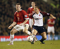 Fotball<br /> FA-cup 2005<br /> Manchester United v Middlesbrough<br /> 29. januar 2005<br /> Foto: Digitalsport<br /> NORWAY ONLY<br /> United's Wayne Rooney and Boro's Ray Parlour