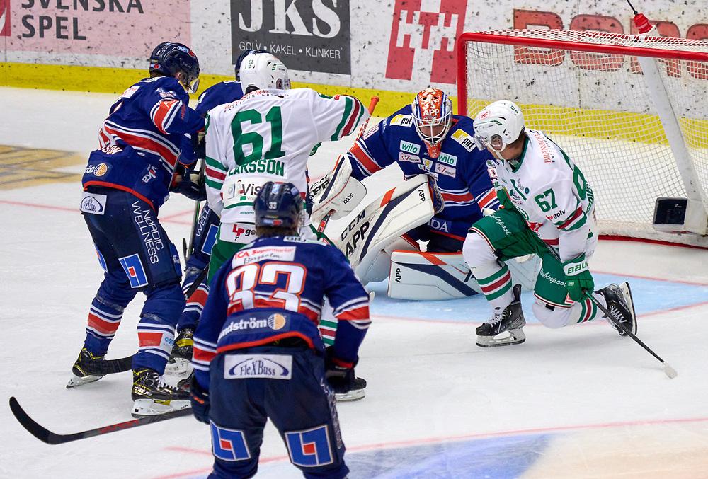 2021-09-25 VÄXJÖ<br /> Växjö Lakers - Rögle BK<br /> SHL Omgång 5<br /> <br />  ***betalbild***<br /> <br /> Foto: Peo Möller<br /> <br /> SHL, ishockey, Växjö Lakers, is, rink, spelare, hockey, hockeyspelare, Växjö, ishall, Vida Arena, Rögle BK, Rögle