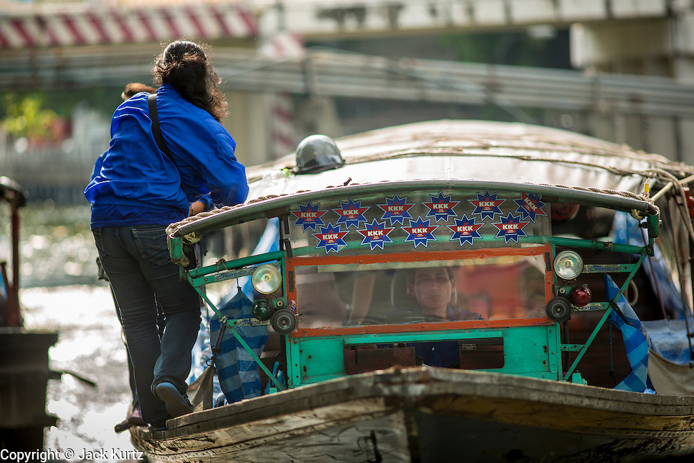 14 NOVEMBER 2012 - BANGKOK, THAILAND: A passenger boat pulls into the Wat Sriboonreung Pier, the southern terminal of the Khlong Saen Saeb boat service. Bangkok used to be criss crossed by canals (called Khlongs in Thai) but most have been filled in and paved over. Khlong Saen Saeb is one of the few remaining khlongs in Bangkok with regular passenger boat service. Boats and ships play an important in daily life in Bangkok. Thousands of people commute to work daily on the Chao Phraya Express Boats and fast boats that ply Khlong Saen Saeb. Boats are used to haul commodities through the city to deep water ports for export.      PHOTO BY JACK KURTZ