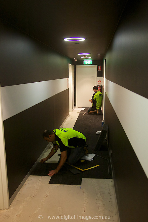 Systemised Carpet Laying for Multi story apartment buildings, high rises and office blocks.  <br /> FTG Resiflor installation at Chevron Apartments, Melbourne.<br /> Loading dock, lifts and 3rd floor corridors. <br /> 29 May, 2014.